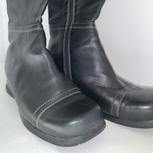 Women's black leather zippered boots